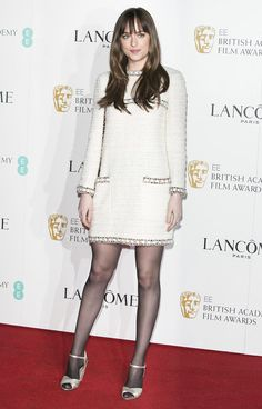 Dakota Johnson stepped out in a stunning Chanel long-sleeve cream tweed dress.
