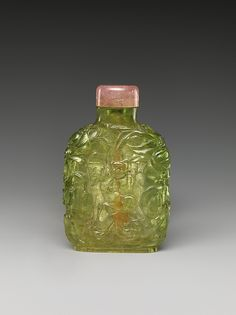 Snuff Bottle with Old Man Carrying a Boy Period: Qing dynasty (1644–1911) Date: late 18th century Culture: China Medium: Green tourmaline with pink tourmaline stopper