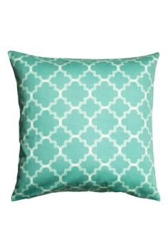 Printed cushion cover: Cushion cover in a patterned cotton weave with a concealed zip.
