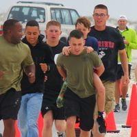 Marines Help Handicap Boy Finish Race