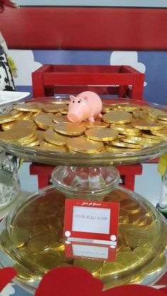 Ham's gold coins at a Toy Story birthday party! See more party ideas at CatchMyParty.com!