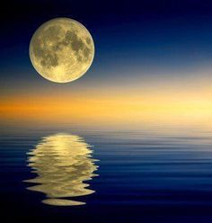 serene - reflection of the moon over the ocean