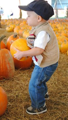 Favorite fall pic of all time!! ( he was determined to get that pumpkin to the checkout counter, even if it was 1/3 his body weight)