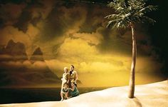 South Pacific. Vivian Beaumont Theater, New York (Broadway). Design by Michael Yeargan. The main design element would be color. There are a lot of warm colors that make the place seem sunny. The palm tree the diagonal lines of the sand, and mountain range is another great element. This set is effective because it makes me feel like I am on an exotic island. The scenic painting is rather incredible.
