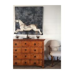 Antique horse, French accent chairs, Neoclassical chest.   Amy Meier Design Studio - Rancho Santa Fe, CA