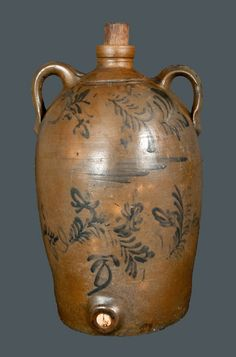 "Very Rare Morgantown, WV Stoneware Commemorative Water Cooler with Elaborate Flowering Vine Decoration, attributed to the Thompson Pottery, Morgantown, WV, circa 1875, semi-ovoid jug with tooled shoulder and spout, ribbed open handles, and circular bung hole at base, decorated on the front with two rows of flowering vines separated by cobalt brushwork. Reverse decorated with the cobalt inscription ""Bael(?) Simpson / July 12th, 1809 / Morgantown Wst. Va. / Nov. 11th [??]."" Handles decorated…"