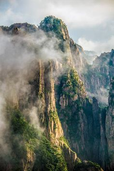 Mist clearing from the peaks of Huangshan (Yellow Mountains), China. Mike Hollman