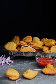 Nigerian Akara are tasty fried black eyed pea fritters that can be served by themselves, a side of pap, with garri, custard, porridge oats or in a burger.