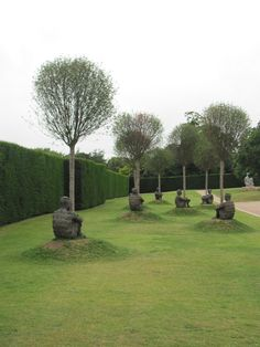 Jaime Plensu (seven figures hugging trees at the Yorkshire Sculpture Park