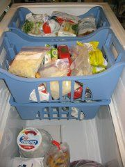Organize a chest freezer using baskets - easy access to all food! Choose baskets that allow air to circulate or contact your freezer manufacturer for baskets specific to your freezer.