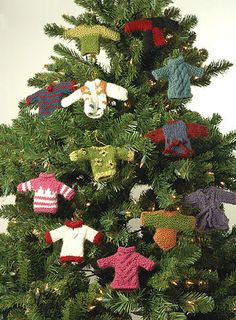 Knitting Projects: 11 Homemade Ornaments - Knit Miniature Sweater Ornaments for you Christmas tree this year! These knitting projects are perfect little Christmas ornament crafts. Knit Christmas Ornaments, Christmas Knitting, Handmade Christmas, Christmas Sweaters, Christmas Crafts, Christmas Decorations, Tree Decorations, Christmas Jumpers, Christmas Countdown