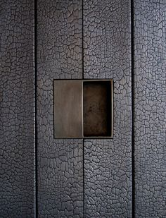 dust db | custom door hardware in the shou sugi ban walls at the tucson mountain retreat