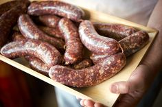 A recipe for Greek Loukaniko sausage, made with pork and lamb and flavored with orange zest. This is a traditional loukaniko.