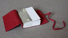 """Mini journal with upcycled suede cover by LinenLaidFelt on Etsy, $30.00. Size: 2.5"""" x 3.5""""  Pages: 140  Style: Italian Longstitch. This book was sewn with white thread in the historical Italian Longstitch binding style, which allows the stitching to become a decorative element on the spine. Pages lay flat when open for easy journaling or sketching."""