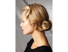 @Byrdie Beauty - Not into tousled? Try an artfully pinned updo like this one from Oh Joy.