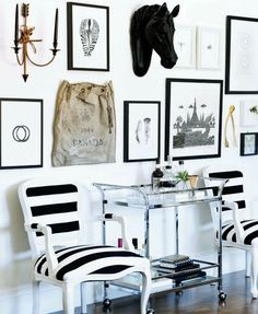 Black and white // picture frames // arrow wall sconce