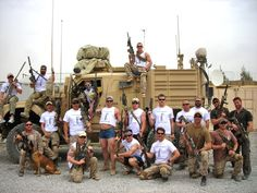 U.S. Navy SEAL Team 3 laid back in Afghanistan. <-- is no one gonna mention booty shorts and crop top