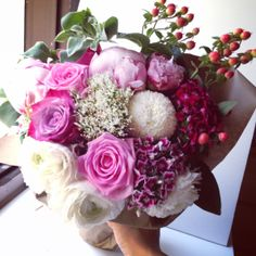 A Mother's Day floral arrangement of peonies, roses, chrysanthemum pom poms, hypericum berry flowers, sweet Williams and ranunculus sent on behalf of Coach to celebrity mummies!