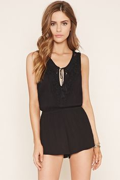 This sleeveless romper is crafted from a gauzy woven fabric with an elasticized…