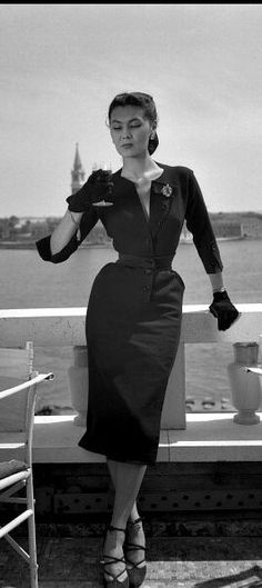 1951. Alla in dress by Christian Dior near the Piazza San Marco in Venice, the island of San Giorgio Maggiore is visible in the background