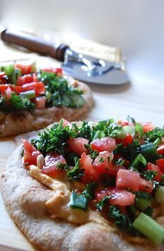 The Best Mediterranean Naan Pizza: a simple dinner of hummus, tomatoes, parsley and a lemon dressing on Naan bread // A Cedar Spoon #sponosored