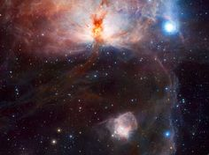 Flame Nebula, or NGC 2024, in the constellation of Orion (the Hunter) and its surroundings.  The wide-field VISTA view also includes the glow of the reflection nebula NGC 2023, just below centre, and the ghostly outline of the Horsehead Nebula (Barnard 33) towards the lower right. The bright bluish star towards the right is one of the three bright stars forming the Belt of Orion.  Credit: ESO/J. Emerson/VISTA. Acknowledgment: Cambridge Astronomical Survey Unit