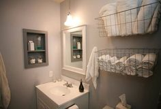 Wire baskets for towels and flannels - great idea! Now where can I find baskets like this?
