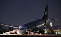 A U.S. Airways Airbus with 149 passengers on board ratterrit emergency after the explosion of a tire
