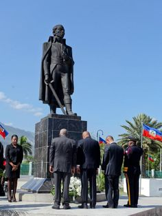 The President of Haiti with the Prime Minister standing in front of the Statue of Toussaint Louverture in Haiti. In commoration of the 210th anniversary of Toussaint Louverture death. In April 7th, 1803.