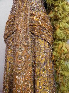 """Sharaff confirmed that in her 1968 interview when she stated, """"The thread used in the Hello, Dolly! dress is made of pure gold. It comes in very fine tubes, is pliable and can be threaded like beads. Because of some technical lighting problems, the pure-gold material was the only way I could achieve the quality that both the director and I wanted."""""""