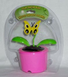 """Solar Powered Dancing BUTTERFLY - Pink Pot (Bubble Package) by Greenbrier. $4.94. When its solar strip is exposed to light - this adorable Butterfly begins to dance and its leaves sway to and fro.  Makes a great gift!  A fun addition to any desk, table, or counter.  4¼"""" tall."""