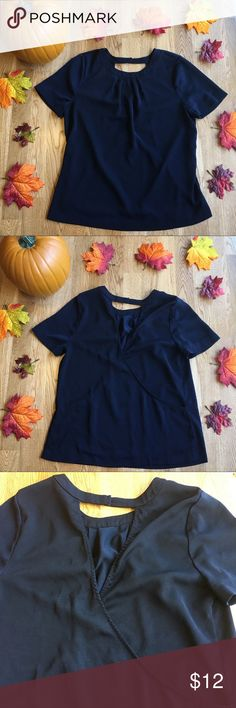 J Crew Navy Blue Top Very stylish navy blue j crew top! The material has a cute crossover design in the back with a small cut out area. Snaps closed at the top in the back. No holes or stains! Please feel free to ask any questions before purchasing :) Make me an offer! J. Crew Tops
