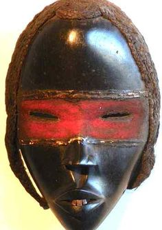 Stunning mahogony colored Dan Mask from Africa-- great red accent -- perfect for decorating with Tribal art