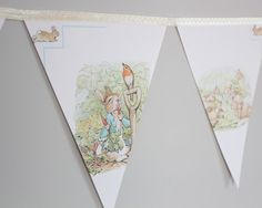 This adorable bunting has been made using vintage Beatrix Potter picture books. It would be great in a Beatrix Potter Peter Rabbit or bunny themed room. Or gorgeous for a baby shower or birthday party. Peter Rabbit Birthday, Peter Rabbit Party, Peter Rabbit Nursery, Bunny Nursery, Nursery Room, Nursery Ideas, Baby Shower Parties, Baby Boy Shower, Beatrix Potter Nursery