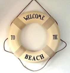 Welcome to the Beach. I love/want a life preserver that looks aged & has words like this one. Is it still appropriate if your house isn't on the beach?