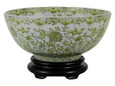 green and white bowl with base.