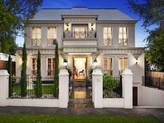 """This French provincial home Melbourne's eastern suburbs has a six-car garage. """"A French provincial house never had a double-car garage in the facade,"""" Melbourne University Professor Philip Goad says. """"A French provincial house never had a car."""""""