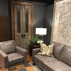 Rustic style door in room setting with huge map poster.