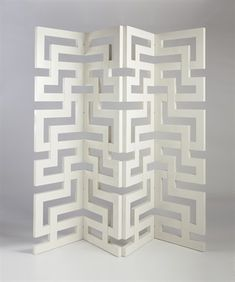 The classic Greek Key pattern goes modern on this floor screen from the Jan Showers Collection.