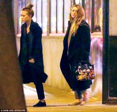 Working women: Former child stars Mary-Kate, left, and Ashley Olsen were spotted leaving their office in New York's West Village looking tired and a little glum on Monday