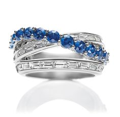 River by Harry Winston, Sapphire and Diamond Ring    13 round sapphires, 1.68 total carats; 26 baguette diamonds, 1.70 total carats; platinum setting.