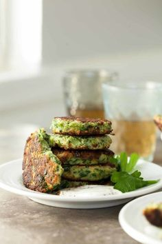 Broccoli Goat Cheese Fritters with Sumac Yogurt - Stuffed with broccoli, goat cheese and herbs, these fritters are golden on the outside and soft and tender on the inside.