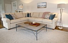the rustic coffee table and vintage inspired lamps from Gabby keep the bachelor vibe in tact