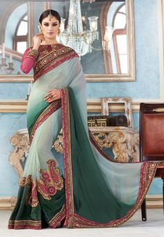 Buy Pastel Green Faux Georgette, Net and Faux Crepe Saree with Blouse online, work: Embroidered, color: Dark Green / Pastel Green, usage: Wedding, category: Sarees, fabric: Georgette, price: $160.13, item code: STN1637, gender: women, brand: Utsav