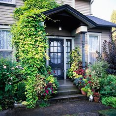 I love the lush, untamed look - it's carefully planned, no doubt, but it isn't perfectly tidy.  Natural, comfy feel to it.  Want a yard like this - densely planted, but not cookie cutter
