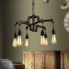 ******FREE DELIVERY UNTIL DECEMBER 31**************  Iron pipe chandelier 4 arms or 6 arms 8 Arms is available contact us.   ITEM DETAILS ➤ Black