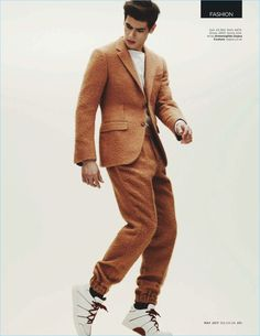 Making a textured statement, Victor Oliveira wears a brown look with sneakers from Ermenegildo Zegna Couture.