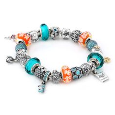 PANDORA Aloha Charm Bracelet - This charm bracelet is beach-ready! The PANDORA Aloha Charm bracelet features teal & orange muranos and CZs paired with all of your favorite ocean-themed charms! Get ready to catch a wave with this adorable bracelet!