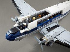 There's room for fourteen passengers and a pilot inside. Lego Plane, Lego Ww2, Lego Kits, Lego Truck, Lego Builder, Lego Construction, Lego Military, Lego Modular, Cool Lego Creations