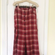 Gypsy Warrior Plaid Skirt with Belt size Small Only been worn one or two times. I hate parting with it but I don't wear it. Red flannel maxi skirt featuring an allover plaid print with ivory and navy accents, a partial button up closure at the front and slits at the front and sides. Includes pocket at the hips, an elastic waistband and a black vegan leather belt. Pull on style. Not trading just selling. Ask any questions. Size small - 100% cotton Gypsy Warrior Skirts Maxi